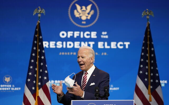 US President-elect Joe Biden, accompanied by Vice President-elect Kamala Harris, speaks about economic recovery at The Queen theater, Monday, Nov. 16, 2020, in Wilmington, Del. (AP Photo/Andrew Harnik)