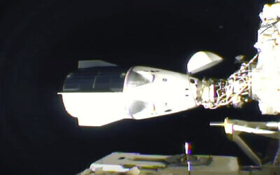 The SpaceX Dragon is seen after docking at the International Space Station, November 16, 2020. (NASA TV via AP)
