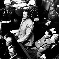 Hermann Goering stands in the prisoner's dock at the Nuremberg War Crimes Trial in Germany, November 21, 1945. (AP Photo, file)