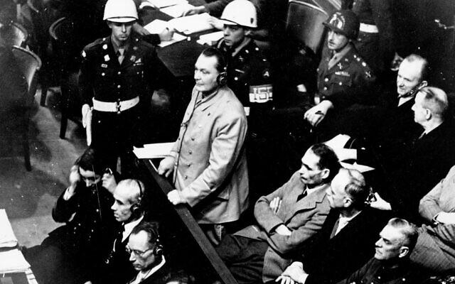 Hermann Goering stands in the prisoner's dock at the Nuremberg War Crimes Trial in Germany, November 21, 1945. (AP Photo, file)