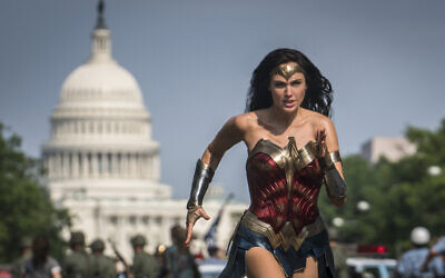 "This image released by Warner Bros. Pictures shows Gal Gadot as Wonder Woman in a scene from ""Wonder Woman 1984."" The film isn't skipping theaters or moving to 2021, but it is altering course. The last big blockbuster holdout of 2020 is still opening in U.S. theaters on Christmas Day but it will also be made available to HBO Max subscribers free of charge for its first month, Warner Bros. said Wednesday, Nov. 18, 2020. (Clay Enos/Warner Bros Pictures via AP)"