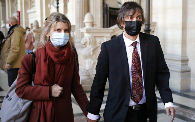 French-American Mark Moogalian, right, and his wife Isabelle arrive at the Thalys attack trial, at the Paris courthouse, November 19, 2020. (AP Photo/Francois Mori)