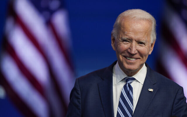 In this Nov. 10, 2020 file photo, President-elect Joe Biden smiles as he speaks at The Queen theater in Wilmington, Delaware (AP Photo/Carolyn Kaster, File)