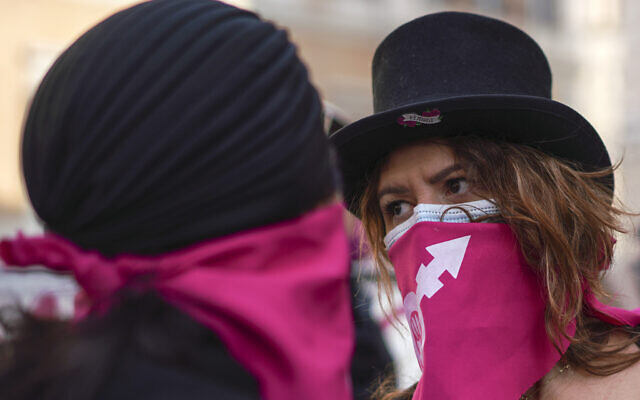 Women take part in a demonstration on the International Day for the Elimination of Violence against Women, in Rome, Wednesday, Nov. 25, 2020. (AP Photo/Andrew Medichini)
