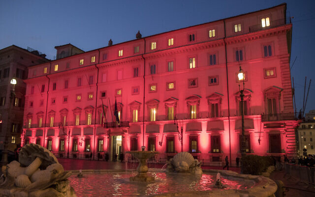 Chigi Palace Italian government's office is illuminated in red on the occasion of International Day for the Elimination of Violence against Women, in Rome, Wednesday, Nov. 25, 2020. (Roberto Monaldo/LaPresse via AP)
