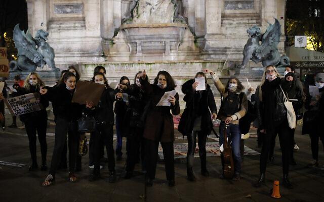 Women gather at the Saint Michel fountain Wednesday, Nov. 25, 2020 in Paris. (AP Photo/Francois Mori)