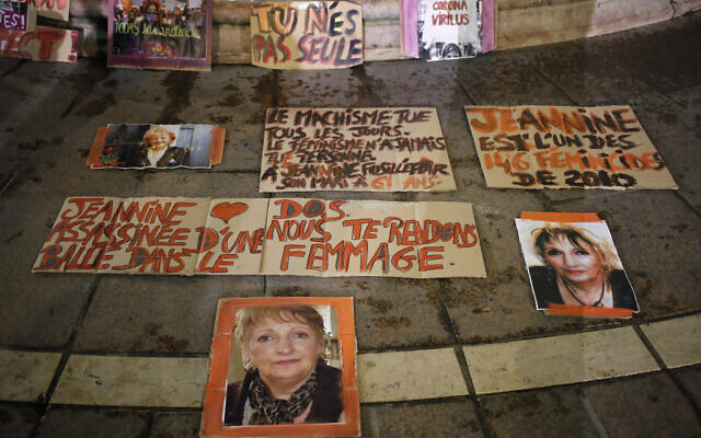 Posters of women victims of domestic violence are pictured at the Saint Michel fountain Wednesday, Nov. 25, 2020 in Paris.  (AP Photo/Francois Mori)