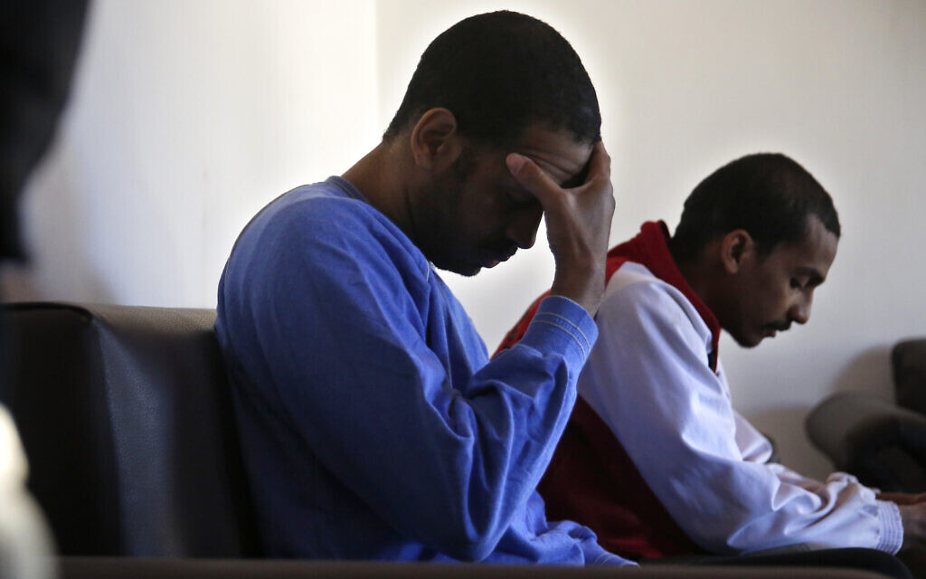 Alexanda Amon Kotey, left, and El Shafee Elsheikh, who were allegedly among four British jihadis who made up a brutal Islamic State cell dubbed 'The Beatles,' during an interview with The Associated Press at a security center in Kobani, Syria, March 30, 2018. (AP Photo/Hussein Malla, File)