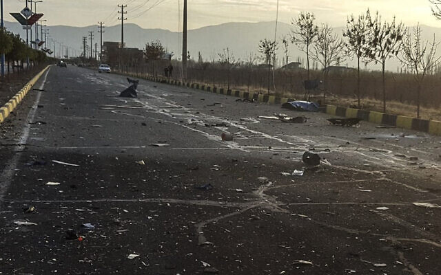 This photo released by the semi-official Fars News Agency shows the scene where Mohsen Fakhrizadeh was killed in Absard, a small city just east of the capital, Tehran, Iran, November 27, 2020. (Fars News Agency via AP)