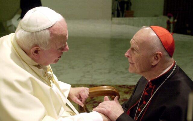 US Cardinal Theodore Edgar McCarrick, archbishop of Washington, DC (left) shakes hands with Pope John Paul II during the General Audience with the newly appointed cardinals in the Paul VI hall at the Vatican, February 23, 2001 (AP Photo/Massimo Sambucetti)