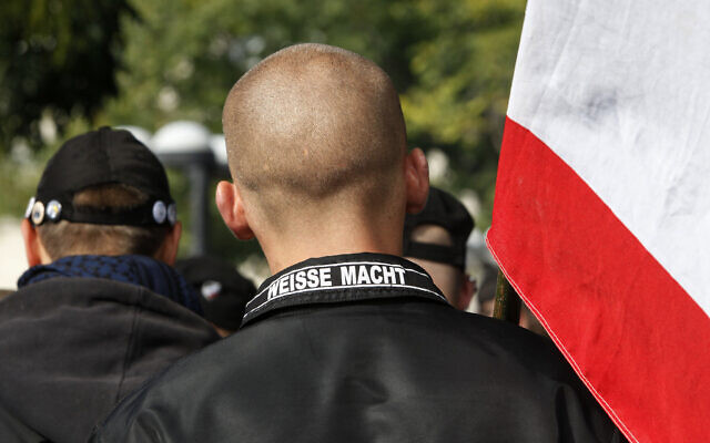 Illustrative: A man wears a jacket with writing on the collar which reads 'White Power' at a neo-Nazi rally in Berlin, October 10, 2009. (AP Photo)