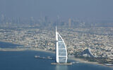 Burj Al Arab, a luxury hotel, foreground, and Burj Dubai, the world's tallest building, in background center, seen from a plane in Dubai, United Arab Emirates, January 3, 2010. (AP Photo/Kamran Jebreili/File)