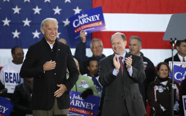 Vice President Joe Biden, left, and Delaware Democratic US Senate candidate Chris Coons, right, applaud while attending a rally for the Delaware Democratic Party ticket on November 1, 2010, in Wilmington, Del. (AP/Rob Carr)