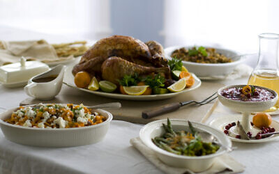 A Thanksgiving turkey surrounded by side dishes.  (AP Photo/Matthew Mead, FIle)