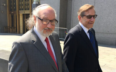 Convicted spy Jonathan Pollard, left, with his lawyer, Eliot Lauer, leaves federal court in New York following a hearing, Friday, July 22, 2016. (AP/Larry Neumeister)