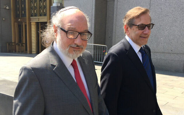 Convicted spy Jonathan Pollard, left, with his lawyer, Eliot Lauer, leaves federal court in New York following a hearing, Friday, July 22, 2016. Pollard was freed in November  2015 after serving 30 years in prison after admitting to giving secrets  to Israel. (AP/Larry Neumeister)