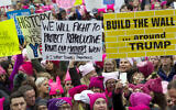 Women with bright pink hats and signs begin to gather early and are set to make their voices heard on the first full day of Donald Trump's presidency, Jan. 21, 2017 in Washington ( AP Photo/Jose Luis Magana)