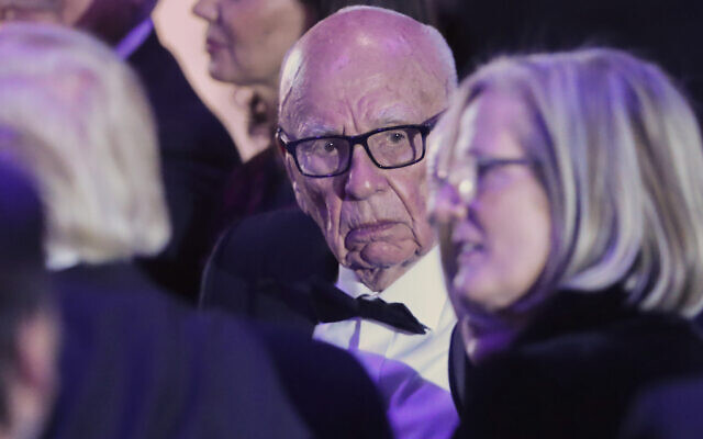 Rupert Murdoch, center, Chairman of Fox News Channel with US Donald Trump, left (with back to camera), Australian Prime Minister Malcolm Turnbull and his wife Lucy Turnbull, right, during dinner aboard the USS Intrepid, a decommissioned aircraft carrier docked in the Hudson River in New York on May 4, 2017. (AP/Pablo Martinez Monsivais)