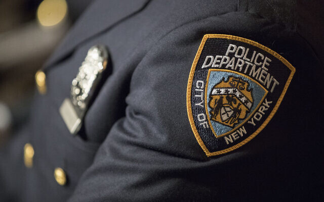 Illustrative: A detail including the badge and shield of one of the newest members of the New York City police is seen during his graduation ceremony, June 29, 2017, in New York. (AP Photo/Mary Altaffer)