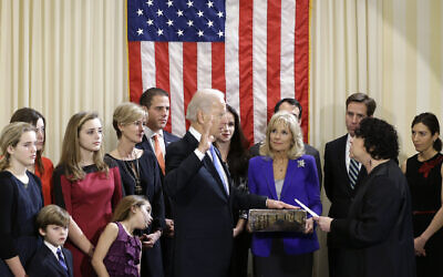 File: Then-US Vice President Joe Biden, with his wife Jill Biden holding the Biden Family Bible, takes the official oath of office from Supreme Court Justice Sonia Sotomayor, surrounded by family, during an official ceremony at the Naval Observatory, January 20, 2013, in Washington. (AP Photo/Carolyn Kaster)