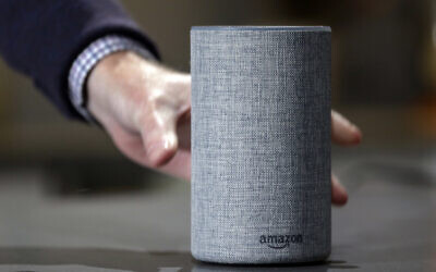 In this Sept. 27, 2017 photo, a new Amazon Echo is displayed during a program announcing several new Amazon products by the company, in Seattle. (AP Photo/Elaine Thompson, File)