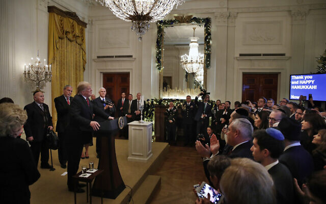 People in the audience applaud as US President Donald Trump speaks during a Hanukkah reception on December 6, 2018, in the East Room of the White House in Washington. (AP/Jacquelyn Martin)