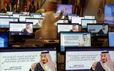 "Illustrative: Screensavers showing King Salman are visible on computers at the press center for upcoming summits, in Mecca, Saudi Arabia, Thursday, May 30, 2019. Arabic on computers reads, ""Despite all the challenges facing our Arab nation. We are optimistic about a promising future that fulfills the hopes of our nations for leadership."" (AP Photo/Amr Nabil)"