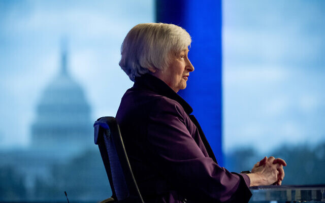 The Capitol Dome is visible in the window behind former Fed Chair Janet Yellen as she appears for an interview with FOX Business Network guest anchor Jon Hilsenrath in the Fox Washington bureau, Wednesday, Aug. 14, 2019, in Washington. (AP Photo/Andrew Harnik)