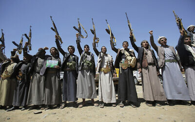 In this Sept. 21, 2019 file photo, Shiite Houthi tribesmen hold their weapons as they chant slogans during a tribal gathering showing support for the Houthi movement, in Sanaa, Yemen (AP Photo/Hani Mohammed)