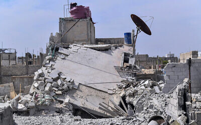 Illustrative: This photo released by the Syrian official news agency SANA, shows the rubble of a house that according to the Syrian authorities was attacked by an Israeli airstrike, in the Damascus suburbs of Hajira, Syria, Monday, April 27, 2020.  (SANA via AP)