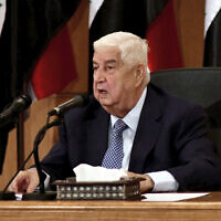 In this photo released by the Syrian official news agency SANA, Syrian Foreign Minister Walid al-Moallem speaks during a press conference, in Damascus, Syria, June 23, 2020 (SANA via AP)