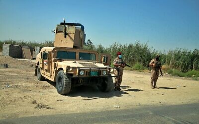 Illustrative: Security forces deployed in Tarmiyah, where a commander of an Iraqi army brigade was killed last week in an attack blamed on the Islamic State group, in Tarmiyah, 35 kilometers (20 miles) north of Baghdad, Iraq, Monday, July 20, 2020.  (AP Photo/Khalid Mohammed, Pool)