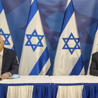 Israeli Prime Minister Benjamin Netanyahu, right, and Israeli Defense Minister Benny Gantz issue a statement at the Israeli Defense Ministry in Tel Aviv, Israel, Monday, July 27, 2020. (AP Photo/Tal Shahar, Yediot Ahronot, Pool)