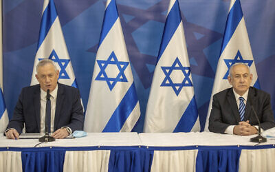 Prime Minister Benjamin Netanyahu, right, and Defense Minister Benny Gantz issue a statement at the Defense Ministry in Tel Aviv, July 27, 2020. (AP Photo/Tal Shahar, Yediot Ahronoth, Pool)