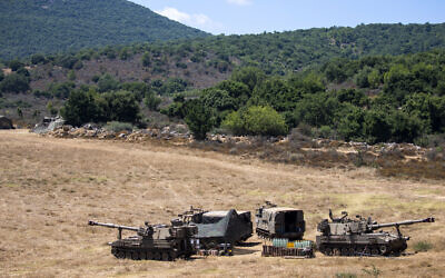 Israeli soldiers sit in a tent next to their mobile artillery piece near the border with Lebanon, northern Israel, Wednesday, Aug. 26, 2020. (AP/Ariel Schalit)