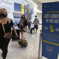 Illustrative -- Passengers arrive at Heathrow Airport, Sept. 8, 2020 (Yui Mok/PA via AP)