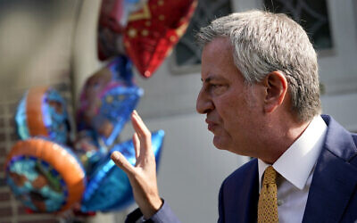 New York Mayor Bill de Blasio talks during a news conference outside the Mosaic Pre-K Center on the first day of school, Monday, Sept. 21, 2020, in New York. The city public schools delayed reopening for two weeks.(AP Photo/Mark Lennihan)