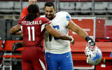 Arizona Cardinals wide receiver Larry Fitzgerald (11) greets Detroit Lions offensive guard Oday Aboushi (76) after an NFL football game, September 27, 2020, in Glendale, Arizona. (AP Photo/Rick Scuteri)