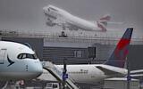 Aircraft are seen at London's Heathrow Airport, Thursday, Oct. 8, 2020 (Steve Parsons/PA via AP)