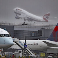 Aircraft are seen at London's Heathrow Airport, Thursday, Oct. 8, 2020 (Steve Parsons/PA via AP)