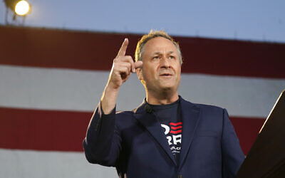 Doug Emhoff, husband of Democratic vice presidential candidate Kamala Harris, speaks during a car rally at East High School, late Thursday, Oct. 8, 2020, in Denver. Motorists took part in the rally to urge people to get out and vote in the upcoming election. (AP Photo/David Zalubowski)