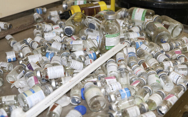 Illustrative: Empty vaccine bottles lie on a tray inside a small clinic in Gampela village on the outskirts of Burkina Faso's capital, Ouagadougou, Saturday Oct. 10, 2020.(AP/Sam Mednick)