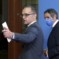 Rafael Mariano Grossi, right, director general of International Atomic Energy Agency (IAEA) and German Foreign Minister Heiko Maas, left, leave after a press conference as part of a meeting in Berlin, Germany, Oct. 26, 2020. (AP/Michael Sohn, pool)