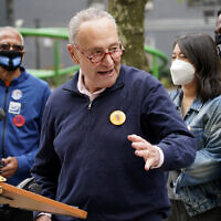 New York Senator Chuck Schumer speaks at a news conference outside an early voting site in New York, Oct. 27, 2020 (AP Photo/Seth Wenig)