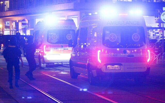 Police officers walk to ambulances at the scene after gunshots were heard, in Vienna, November 2, 2020. (AP Photo/Ronald Zak)