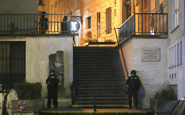 Police officers stay in position at stairs named 'Theodor Herzl Stiege' near a synagogue after gunshots were heard, in Vienna, Monday, Nov. 2, 2020. Austrian police say several people have been injured and officers are out in force following gunfire in the capital Vienna. Initial reports that a synagogue was the target of an attack couldn't immediately be confirmed. Austrian news agency APA quoted the country's Interior Ministry saying one attacker has been killed and another could be on the run.(AP Photo/Ronald Zak)