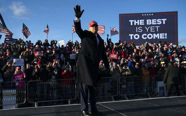 US President Donald Trump walks off stage after speaking during a campaign rally at Wilkes-Barre Scranton International Airport, Monday, Nov. 2, 2020, in Avoca, Pa. (AP Photo/Evan Vucci)