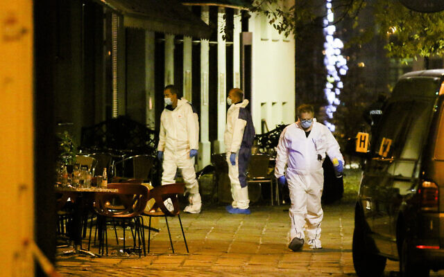 Investigators at the scene following a shooting attack in the Austrian capital Vienna, November 3, 2020. (Ronald Zak/AP)