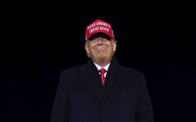 US President Donald Trump smiles at supporters after a campaign rally at Gerald R. Ford International Airport, November 3, 2020, in Grand Rapids, Michigan. (AP Photo/Evan Vucci)