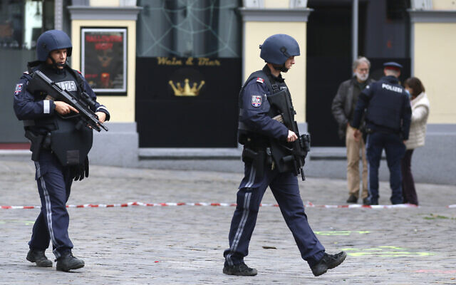 After a shooting armed police officers patrol on a street at the scene in Vienna, Austria, Nov. 3, 2020 (AP Photo/Ronald Zak)
